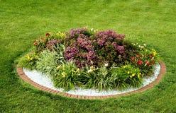 Round Flower Garden - Brick Border stock image