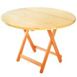 Round folding wooden table for outdoor recreation. Stock Image