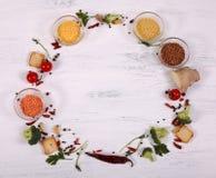 Round food frame on white wooden table. stock photos