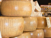 Round forms of Parmigiano Reggiano Italian cheese for sale Royalty Free Stock Photos
