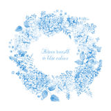 Round frame of blue hydrangea and other flowers. Royalty Free Stock Photo
