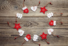 Round frame with Christmas decorations on an old wooden table. S Royalty Free Stock Image