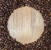 Round frame from coffee beans Stock Photos