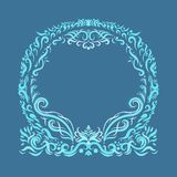 Round frame with exquisite pattern on a blue background.  Royalty Free Stock Images