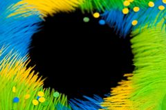 Round frame of feathers for the Brazilian carnival. The colors o. Poster for the carnival. Bright festive feathers in the color of the flag of Brazil Royalty Free Stock Photo