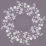 Round frame with flowers and leaves isolated on purple backgroun Royalty Free Stock Image