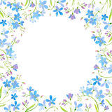 Round frame with forget-me-nots flowers. Royalty Free Stock Photo