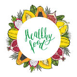 Round frame of fruits and tropical leaves. With the words Healthy food. White background. Lettering Royalty Free Stock Images