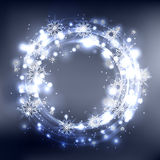 Round frame with glowing sparks and snowflakes. On a blurred background with place for text. Vector element for your design Royalty Free Stock Photography