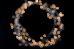 Round frame of luminous garland unfocused, free space for your design in the center. stock photos