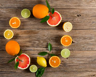 Round frame made of citrus fruits Royalty Free Stock Photo