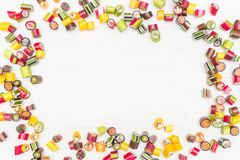 A round frame made of colored caramel candies Royalty Free Stock Image