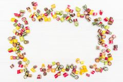 A round frame made of colored caramel candies Stock Photography