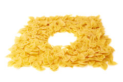 Round frame made of dry farfalle pasta over isolated white background Royalty Free Stock Photos