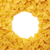 Round frame made of dry farfalle pasta over isolated white background Royalty Free Stock Image