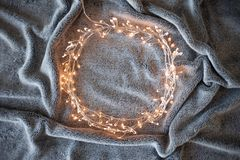 Round frame made of luminous garland, free space for your design in the center. stock photo