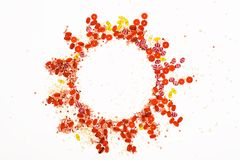 Round frame made with red, pink and yellow beads. On white background Royalty Free Stock Image
