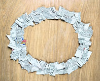 Round frame made of shredded newspaper pieces. Royalty Free Stock Images