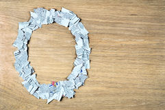 Round frame made of shredded newspaper pieces. Royalty Free Stock Photography