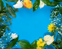 Round frame made of yellow and white summer flowers with green leaves. Valentine`s background stock photography