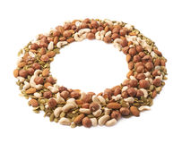 Round frame of nuts and seeds Royalty Free Stock Image