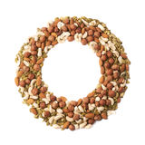 Round frame of nuts and seeds Royalty Free Stock Photo