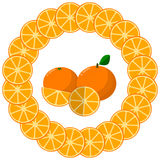 Round frame of orange slices in the center of an orange. Royalty Free Stock Image