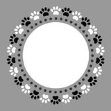 Round frame with paw prints of a dog. Stock Photo