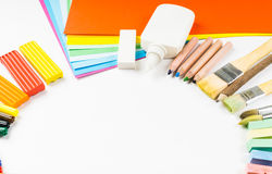 Round frame from pencils, felt-tip pens and paper Royalty Free Stock Photos