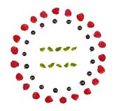 Round frame of raspberry and black currant isolated on white background. Flat lay. Top view stock photo