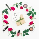 Round frame with roses, cosmetics, gift box and card with written quote `My love` on white background. Flat lay, top view. Valenti. Ne`s day stock photo