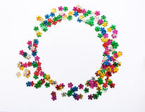 Round frame. Scattered multi-colored sequins in the shape of flowers. Place for your text Royalty Free Stock Images