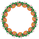 Round frame in shape of wreath with holly berry and jingle bells. Stock Photo
