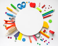 Round frame. Stationery on the white background. Round frame with stationery on the white background. Multicolor pencils and crayons. Place for your text Stock Images