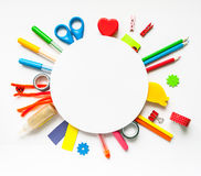 Round frame. Stationery on the white background. Round frame with stationery on the white background. Multicolor pencils and crayons. Place for your text Royalty Free Stock Photo