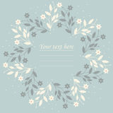 Round frame with summer flowers on light blue background Royalty Free Stock Images