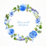 Round frame of watercolor blue flowers and berries. Royalty Free Stock Photos