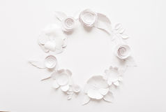 Round frame with white paper flowers. On white background. Cut from paper Royalty Free Stock Photography