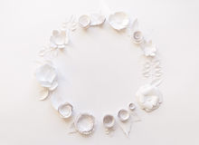 Round frame with white paper flowers. On white background. Cut from paper. Place for your text Royalty Free Stock Photography
