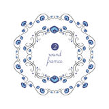 Round frames with blue flowers. On white field Stock Images
