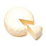Round French Reblochon Cheese. A round of French Petit Reblochon cheese with a wedge Royalty Free Stock Photo