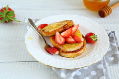 Round French toast with syrup Stock Images