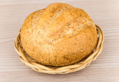 Round fresh buckwheat bread in wicker basket on table Royalty Free Stock Photography