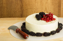 Round of fresh cheese with berries Royalty Free Stock Images