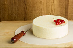 Round of fresh cheese and currants Royalty Free Stock Image