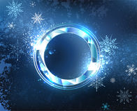 Round frost banner. Round, faceted banner of blue sparkling ice blue cold background with snowflakes. Ice design Royalty Free Stock Photo