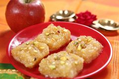 Apple barfee/Apple dessert. The round fruit of a tree of the rose family, which typically has their red or green skin and crisp flesh.nApple gives healthier Stock Photos