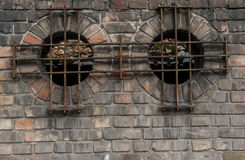 Round gap in a bricked wall. Budapest Royalty Free Stock Images