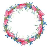 Round garland with spring flowers tulips and and small blue flowers. Decorative saeson floral frame for festive design Stock Image
