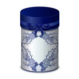 Round gift box with bow and blue lace pattern isolated on a white Stock Photo
